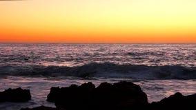 Soluppgång på 'Las rotass strand i Denia stock video