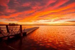 Soluppgång på Lon Hagler Lake i Loveland Colorado Arkivbilder
