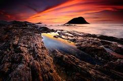 Soluppgång på strand Arkivfoto