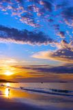 Soluppgång på stranden Arkivbilder
