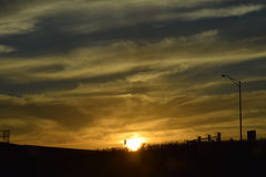 Soluppgång/solnedgång Arkivfoton