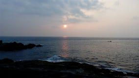 Soluppgång solnedgång, Kovalam strand, Thiruvananthapuram, Kerala Fotografering för Bildbyråer