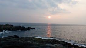 Soluppgång solnedgång, Kovalam strand, Thiruvananthapuram, Kerala Arkivfoton