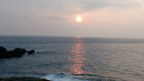 Soluppgång solnedgång, Kovalam strand, Thiruvananthapuram, Kerala Royaltyfria Bilder