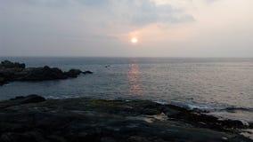 Soluppgång solnedgång, Kovalam strand, Thiruvananthapuram, Kerala Royaltyfri Fotografi