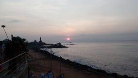 Soluppgång solnedgång, uddecomorin, Kanyakumari, Tamilnadu Arkivfoton