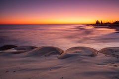 Soluppgångstrand Fotografering för Bildbyråer