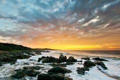 Soluppgångstrand, Sydafrika arkivfoto