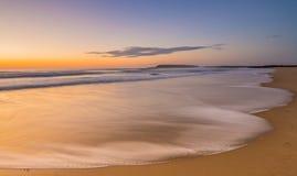 SoluppgångWindang strand Arkivbilder