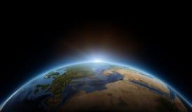 Soluppgång på jord Arkivbild
