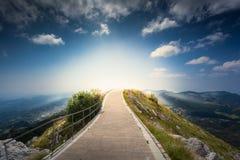 Soluppgång över överkanten av berget Lovcen på Montenegro Fotografering för Bildbyråer