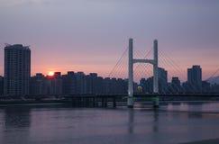 Soluppsättningen av H-bron Royaltyfria Bilder