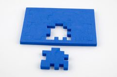 The solution. Blue interlocking puzzle pieces on a white background with the solution in sight stock photo