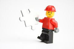 Solution!. Toy worker has a solution puzzle for you Stock Photos