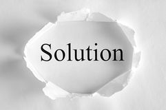 Solution. Solving a business problem with solution in a paper hole Royalty Free Stock Photography