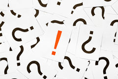 Solution. Single exclamation mark between a lot of question marks - solution or idea concept Royalty Free Stock Photography