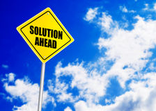Solution ahead message on road sign Stock Image