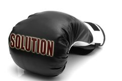 SOLUTION - a boxing glove. A boxing glove and text: solution Royalty Free Stock Photography