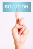 Solution button. Hand push blue solution button, over white background Royalty Free Stock Images