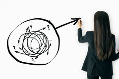 Solution and choice concept. Attractive young businesswoman with drawing arrow doodle on white background stock photo