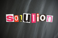 SOLUTION. Colorful SOLUTION letters on Chalkboard Stock Image