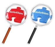 Solution concept. With magnifying glass and puzzle piece Royalty Free Stock Photography