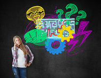 Solution concept. Pensive young woman with creative maze drawing. Solution concept Royalty Free Stock Images