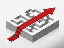 Solution concept. With red arrow going over maze and businessman on concrete background Stock Image