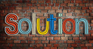 Solution Concepts and Brick Wall in the Background Royalty Free Stock Photography