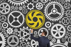 Solution Concepts Gears on Blackboard Background Royalty Free Stock Image