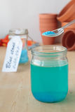Solution of copper sulphate in glass jar Stock Image