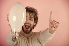 Solution and decision. Power and business success. Happy guy has an idea on pink background, morning. Energy and electricity concept. Man with disheveled hair royalty free stock images