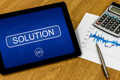 Solution on digital tablet Royalty Free Stock Image