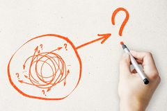 Solution and direction concept. Hand drawing creative arrow doodle on subtle paper background stock image