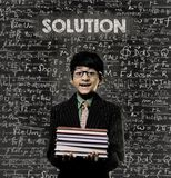 Solution. Genius Little Boy Holding Book Wearing Glasses Chalkbo Stock Photography