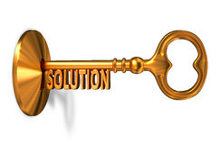 Solution - Golden Key is Inserted into the Keyhole Royalty Free Stock Photography
