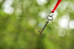 Solution key. Hanging key - solution concept background Royalty Free Stock Photos