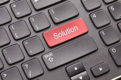 Solution key. Red Solution key on black keyboard Royalty Free Stock Photo