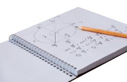 Solution of a mathematical problem in a notebook and pencil lying on paper Stock Image