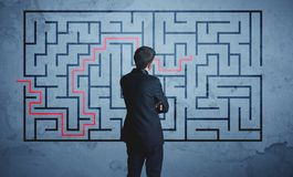Solution of a maze. Businessman finding the solution of a maze Royalty Free Stock Image