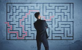Solution of a maze. Businessman finding the solution of a maze Royalty Free Stock Images