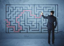 Solution of a maze. Businessman finding the solution of a maze Stock Images