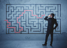 Solution of a maze. Businessman finding the solution of a maze Royalty Free Stock Photography