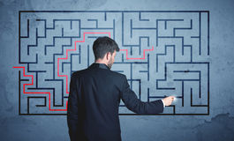 Solution of a maze. Businessman finding the solution of a maze Royalty Free Stock Photo