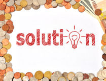 Solution and money Stock Image