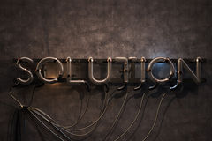 Solution Neon Sign Stock Photo