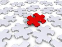 The solution is obvious. 3d red puzzle piece amongst other white ones Stock Image