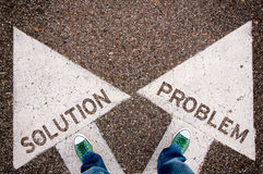 Solution and problem dilemma concept. With man legs from above standing on signs Stock Images