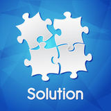 Solution and puzzle pieces over blue background, flat design. Solution and puzzle pieces - white text with symbol over blue background, flat design, business Royalty Free Stock Photo