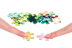 Solution puzzle two women fingers Stock Photo